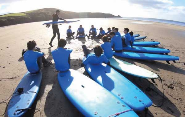 Boys getting surfing instructions
