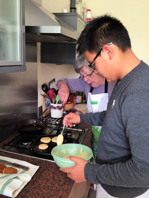 host teaching student how to make drop scones