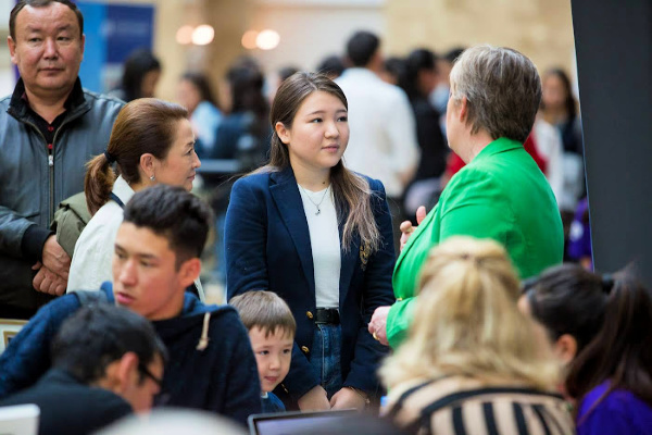 Academic Families Director speaking to a Kazakh student